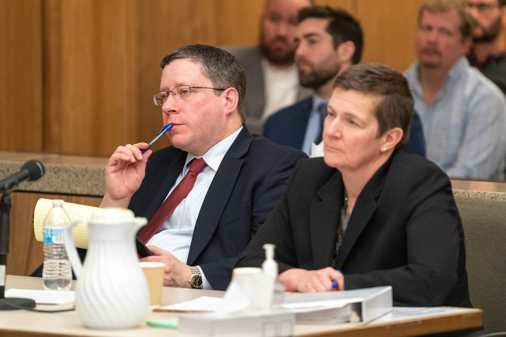 Former Alaska Attorney General Craig Richards, left, and Chief Assistant Attorney General Margaret Paton-Walsh listen to Superior Court Judge Eric Aarseth deliver a decision Friday in Anchorage Superior Court. (Loren Holmes / ADN)