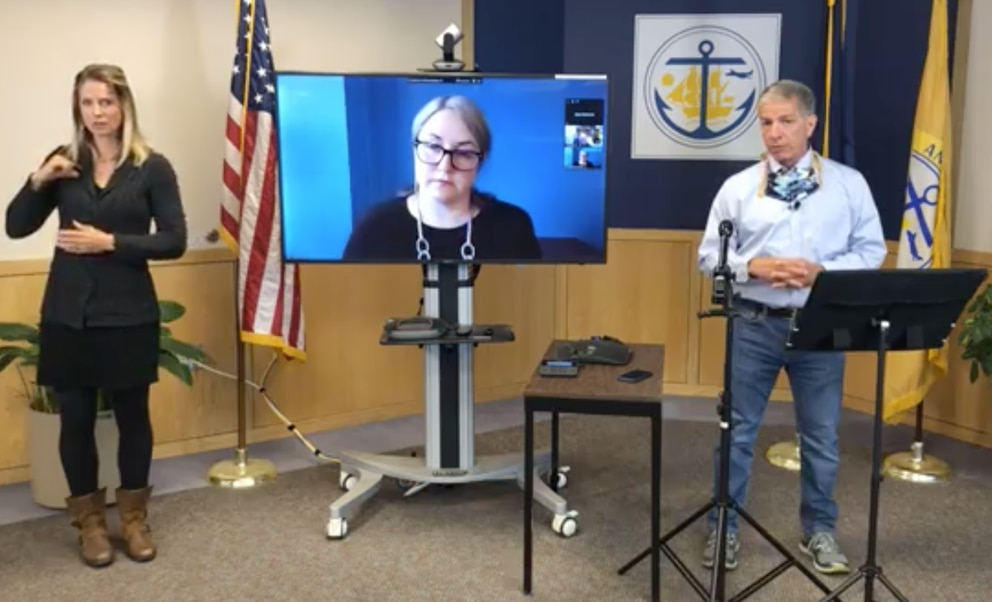 Natasha Pineda, director of the Anchorage Health Department (participating by videoconference), and Mayor Ethan Berkowitz speak during a community briefing on COVID-19 last month. (Screenshot)