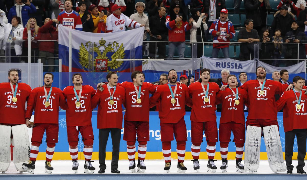 The Russian team sings their national anthem while wearing gold medals. REUTERS/Grigory Dukor
