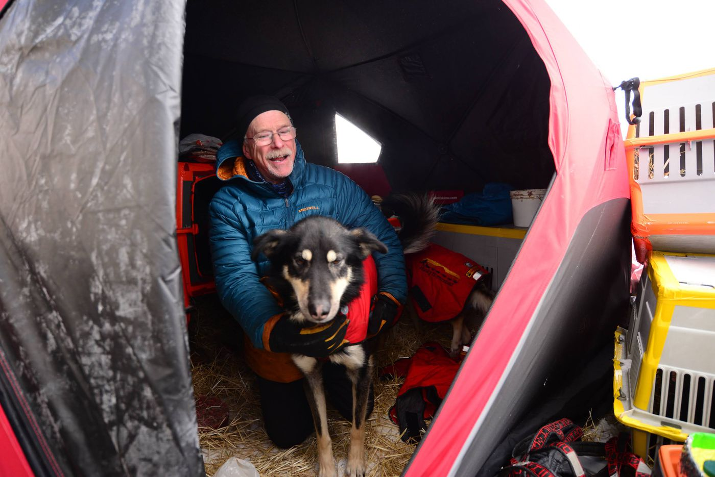 Jeff King waits in a tent in Kotzebue before the start of the Kobuk 440 Sled Dog Race on April 2, 2021. (Photo by Berett Wilber)