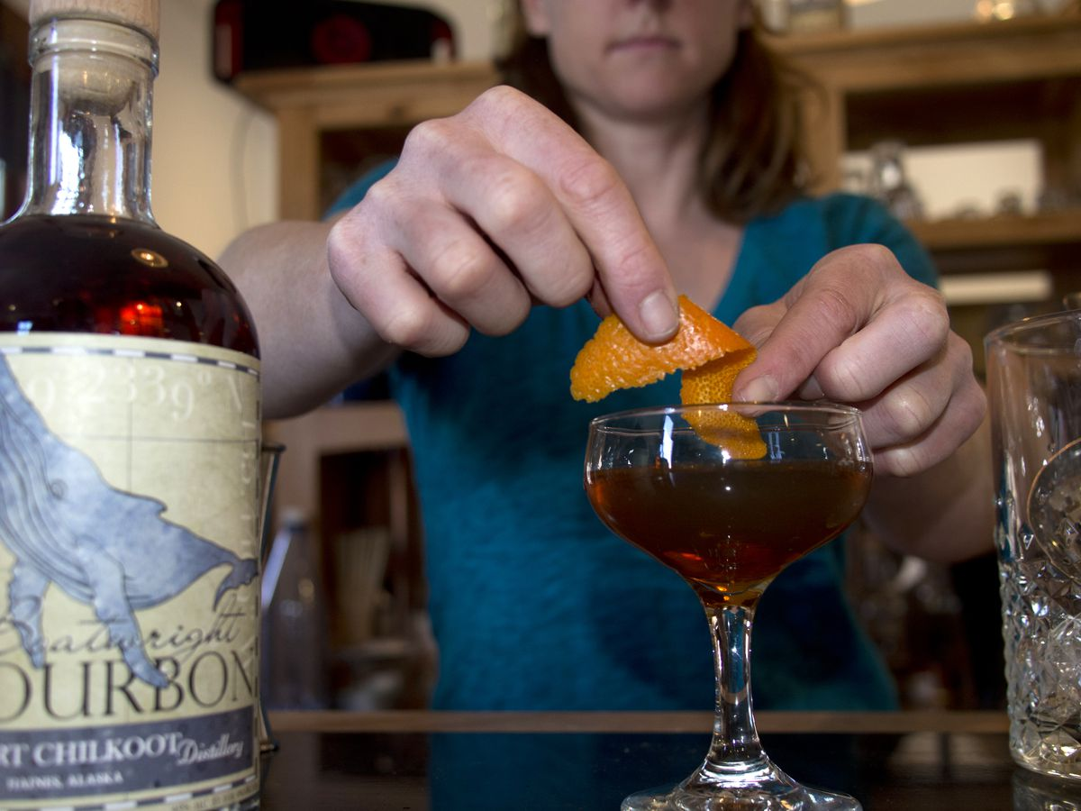 Heather Shade mixes a cocktail at the Port Chilkoot Distillery in Haines. (John Hagen Photography)