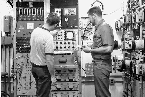 Milrow Atomic Test, Amchitka, Alaska 1969 Wayne Violette and Darrel Oliver making the final checks on the instrumentation equipment before the Atomic Test named Milrow on the Aleutian Island, Amchitka. The Milrow test was a 1 Megaton precurser to the Cannikin test which was the largest undergound test the US conducted at 5 Megatons, almost 400 times the power of the Hiroshima bomb. (DOE Flickr)