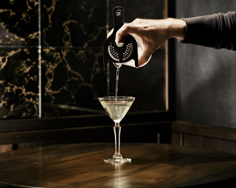 An Alaska cocktail is poured at Golden Teardrops in Chicago. (Whitten Sabbatini/The New York Times)