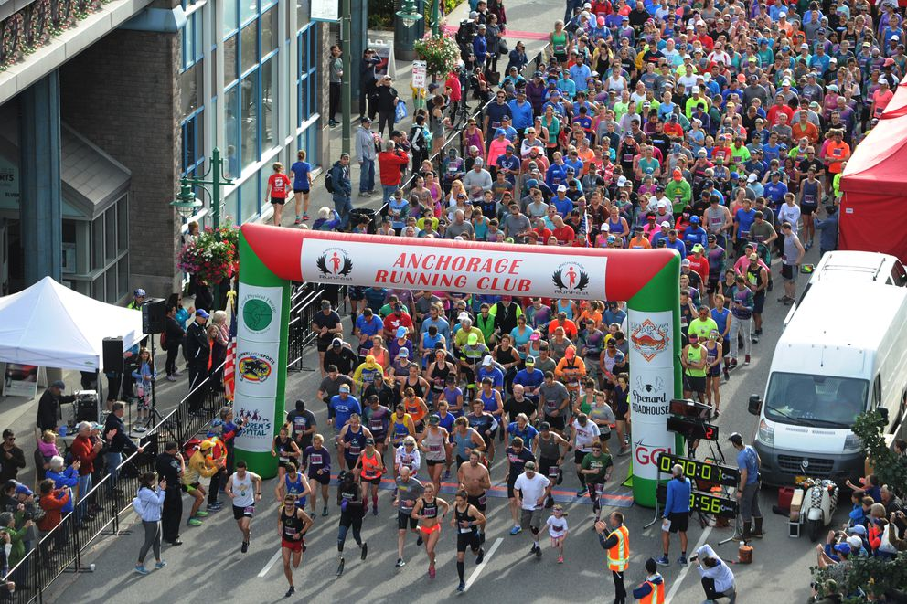 Runners leave the starting line during the Skinny Raven Half Marathon during the Anchorage RunFest on Sunday, August 19, 2018. (Bill Roth / ADN)