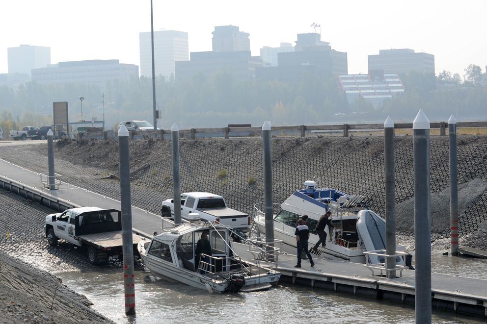The small boat launch at Ship Creek was busy with incoming and outgoing boats on Friday, despite the heavy smoke. Downtown Anchorage has an unhealthy amount of smoke in the air from the Swan Lake fire, Aug. 23, 2019. (Anne Raup / ADN)
