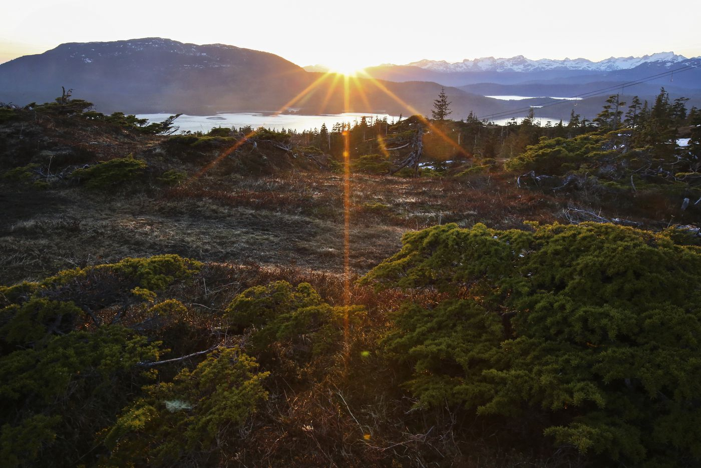 The sun sets behind Hawkins Island around 10 p.m. as a small sliver of Orca Inlet is viewable from the Mt. Eyak Ski Hill Trail in Cordova on Monday, May 17, 2021. (Emily Mesner / ADN)