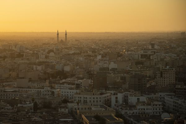 The sun rises over Tripoli, Libya, Friday, Feb. 28, 2020. (AP Photo/Felipe Dana)