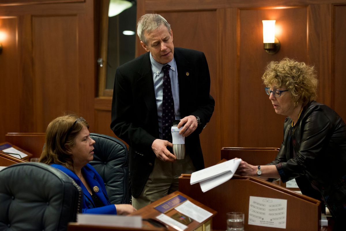 Reps. Tammie Wilson, R-North Pole, and Gabrielle LeDoux, R-Anchorage, talk with Rep. Matt Claman, D-Anchorage, on the House floor last year. Wilson and LeDoux are now in a fight over how the Legislature should move forward after allegations of sexual harassment against a former colleague. (Marc Lester / ADN)