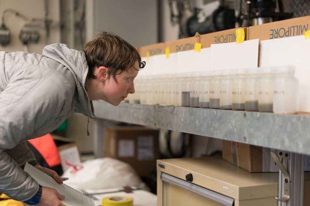 Steffi O'Daly looks at sea water samples from Bering Strait aboard the UAF research ship Sikuliaq. (Photo by Andrew McDonnell)