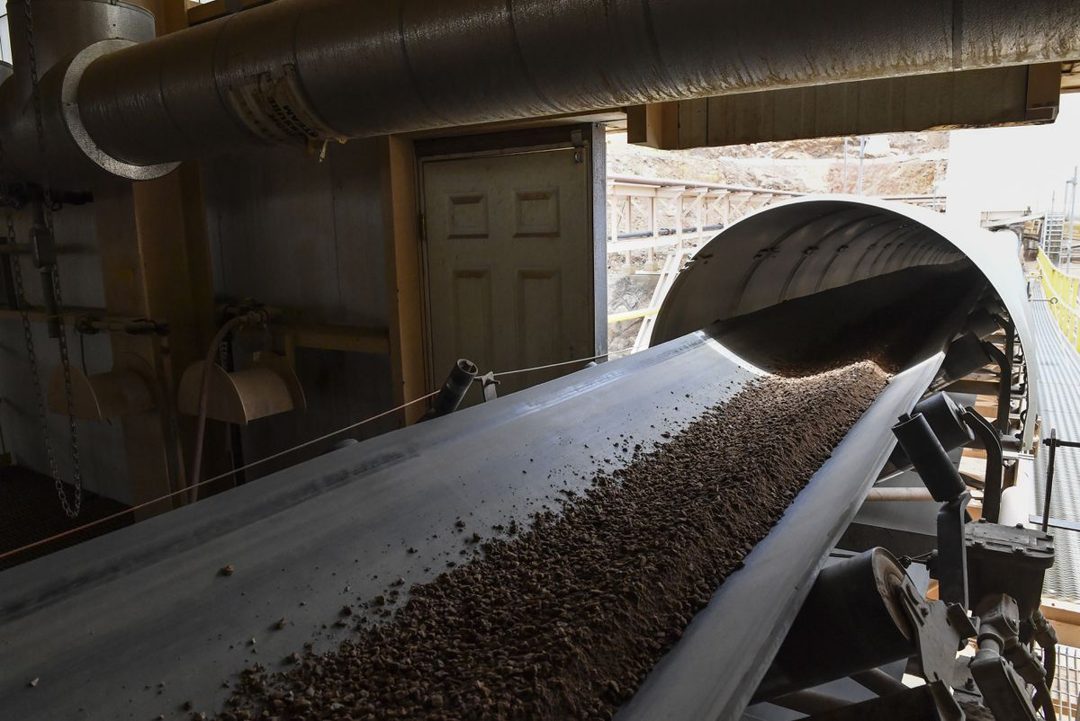 Rare earths product flows down a conveyor belt at the Mountain Pass mine in California, ultimately headed for a processing facility in China. (Washington Post photo by Ricky Cariotti)