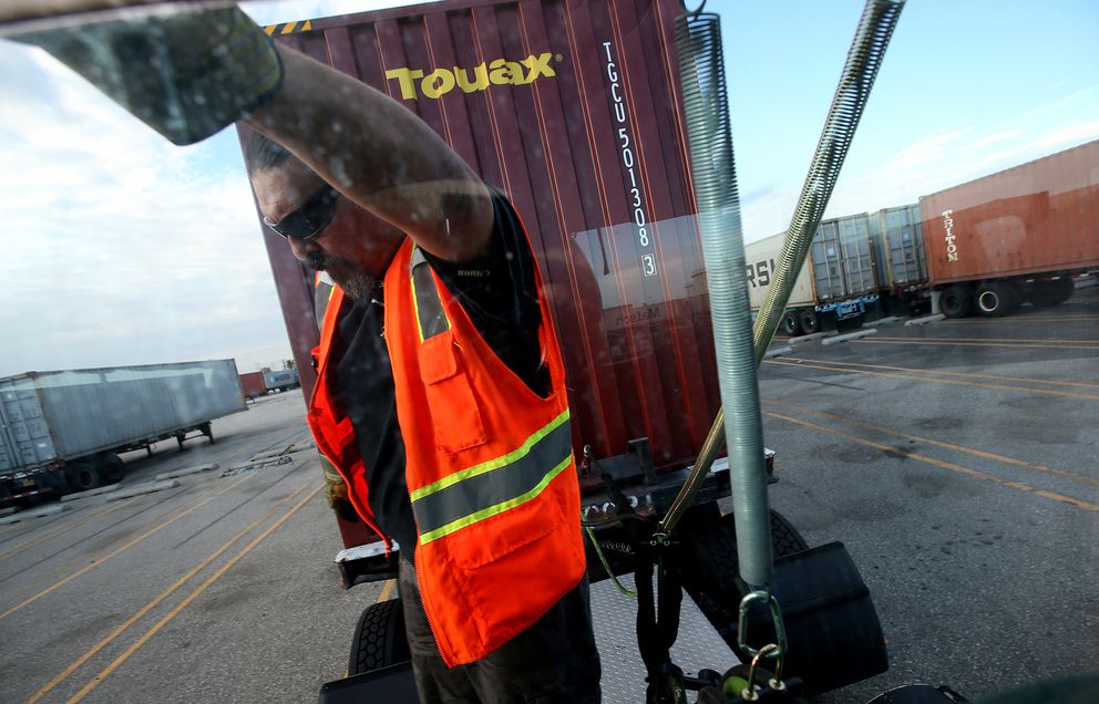 Driver Scott Spendola hooks up a trailer to his big rig truck on Tuesday, Sept. 20, 2016 at the Shippers Transport Express yard in Carson, Calif. Spendola says the advent of automated trucking would eliminate many good-paying jobs for blue collar workers at the ports. (Luis Sinco/Los Angeles Times/TNS)