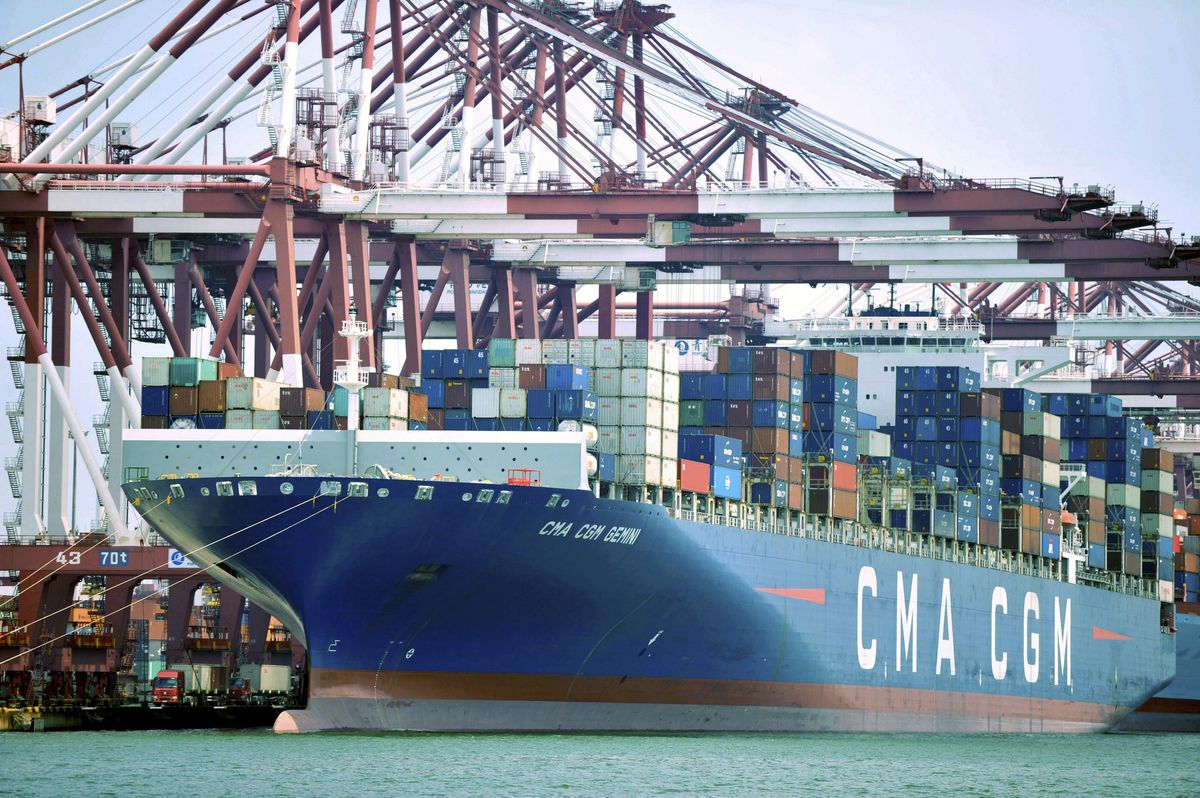 In this July 6, 2018, photo, a container ship is docked at a port in Qingdao in eastern China's Shandong Province. China's government on Wednesday, July 11, 2018, has criticized the latest U.S. threat of a tariff hike as