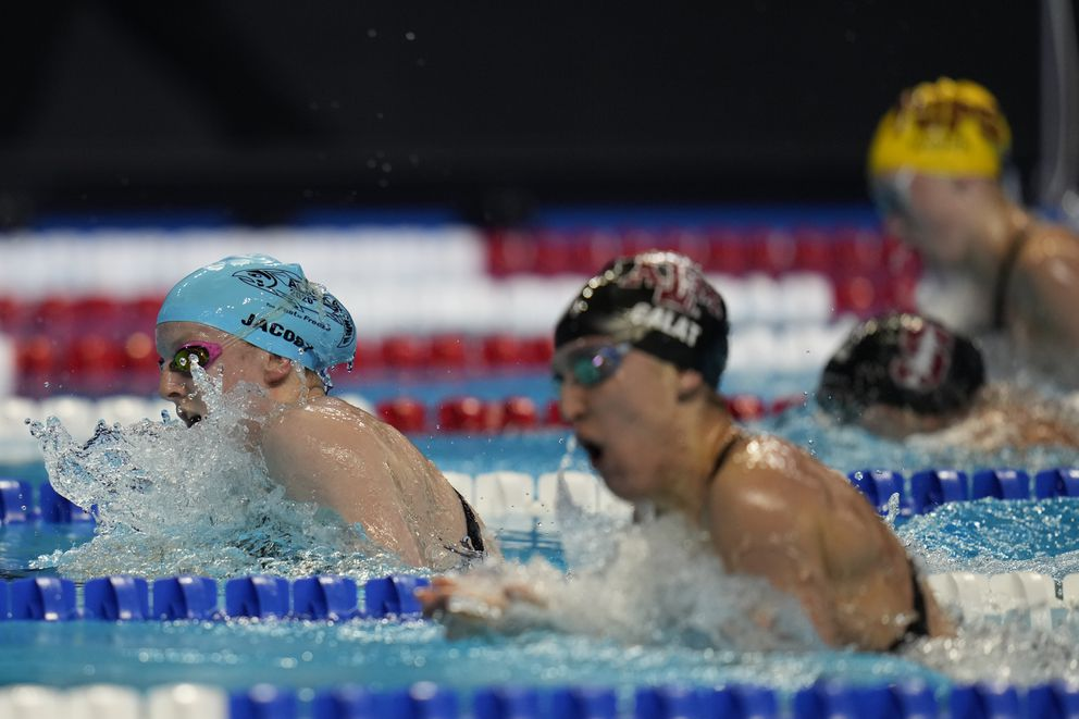 Lydia Jacoby, left, leads a preliminary heat at the Olympic Trials. (AP Photo/Jeff Roberson)