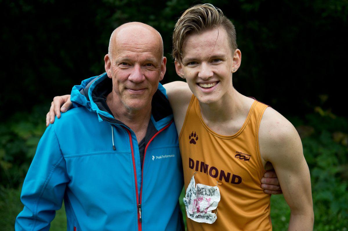 Tuomo Latva-Kiskola, left, and his son Niko Latva-Kiskola, a cross-country runner for Dimond High, at Kincaid Park earlier this season. (Marc Lester / ADN)