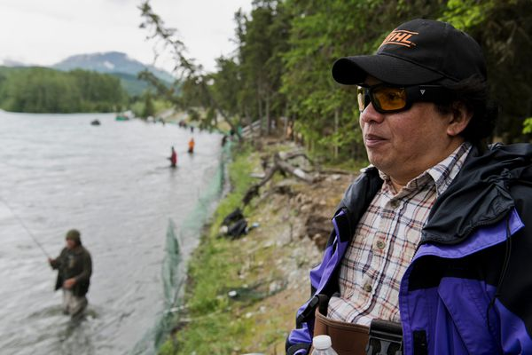 Michael Snow fishes on the Kenai River on June 22, 2018. Snow, from the Philippines, moved to the US for educational opportunities for his three kids. (Marc Lester / ADN)