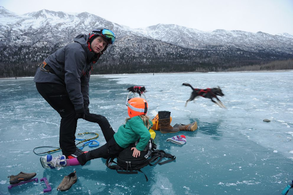 Julia Oswald and her dad, Carl Oswald, wore helmets for a skating outing this month at Eklutna Lake. (Bob Hallinen / ADN)