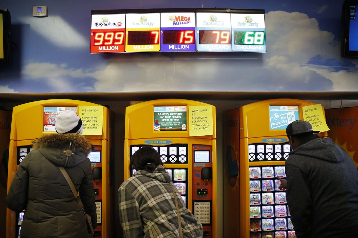 FILE - In this Jan. 12, 2016, file photo, people buy lottery tickets at the Primm Valley Casino Resorts Lotto Store just inside the California border near Primm, Nev. The California Lottery announced in June 2017 that a 19-year-old woman won a total of $655,555 on a pair of $5 scratch-off tickets purchased the same week. (AP Photo/John Locher, File)