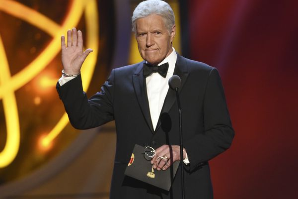 """FILE - This May 5, 2019, file photo shows Alex Trebek gestures while presenting an award at the 46th annual Daytime Emmy Awards in Pasadena, Calif. Jeopardy!"""" host Alex Trebek died Sunday, Nov. 8, 2020, after battling pancreatic cancer for nearly two years. Trebek died at home with family and friends surrounding him, """"Jeopardy!"""" studio Sony said in a statement. Trebek presided over the beloved quiz show for more than 30 years. (Photo by Chris Pizzello/Invision/AP, File)"""