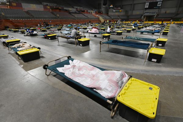 Homeless clients settle in for the night at the Bean's Cafe emergency shelter in the Sullivan Arena on Monday evening, April 27, 2020, during the COVID-19 pandemic. (Bill Roth / ADN)