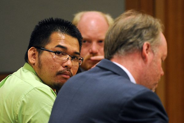 Korakanh Phornsavanh looked around the courtroom before an Anchorage jury found 28-year-old guilty on first- and second-degree murder charges for shooting Said Beshirov, 27, to death outside the Platinum Jaxx bar on Oct. 28, 2012.