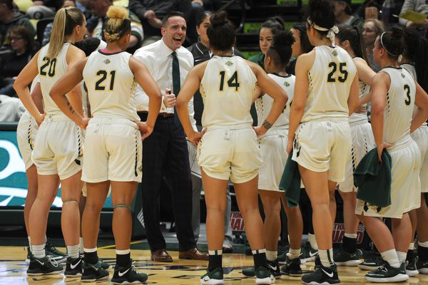 UAA head coach Ryan McCarthy talks to his players during a timeout late in the game during the Seawolves' 81-70 victory over rival UAF Nanooks at the Alaska Airlines Center on Tuesday, Jan. 8, 2019. (Bill Roth / ADN)