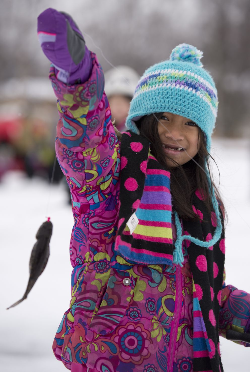 Sarah Iyapana Harris, 7, of Trailside Elementary School, holds up a fish she caught. (Marc Lester / ADN)