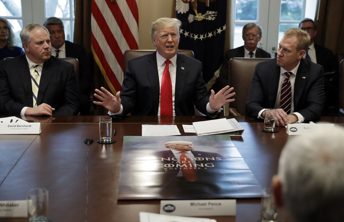 President Donald Trump speaks during a cabinet meeting at the White House, Wednesday, Jan. 2, 2019, in Washington. David Bernhardt, acting interior secretary, is left and Patrick Shanahan, acting defense secretary, is right. (AP Photo/Evan Vucci)