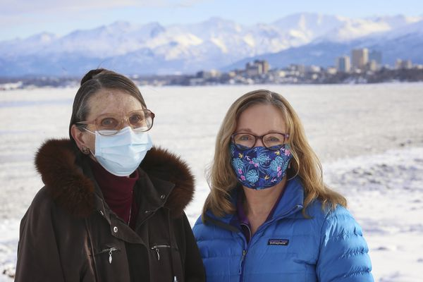 Retired nurses Elizabeth Blair, left and Ginny Hepola in Anchorage on March 5, 2021. Blair and Hepola have been volunteering at vaccine clinics in Anchorage and the surrounding area. (Emily Mesner / ADN)