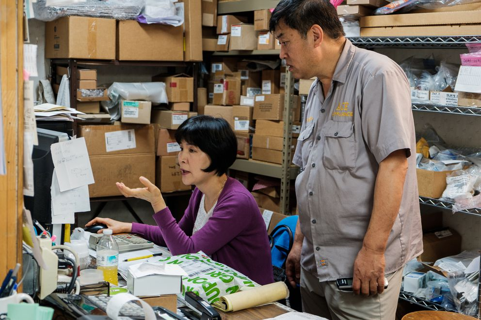 Chun B. Park and his wife, Boon, discuss a part that needs to be ordered. Park and his wife met in South Korea where they worked together for the same home appliance company. (Young Kim / Alaska Dispatch News)