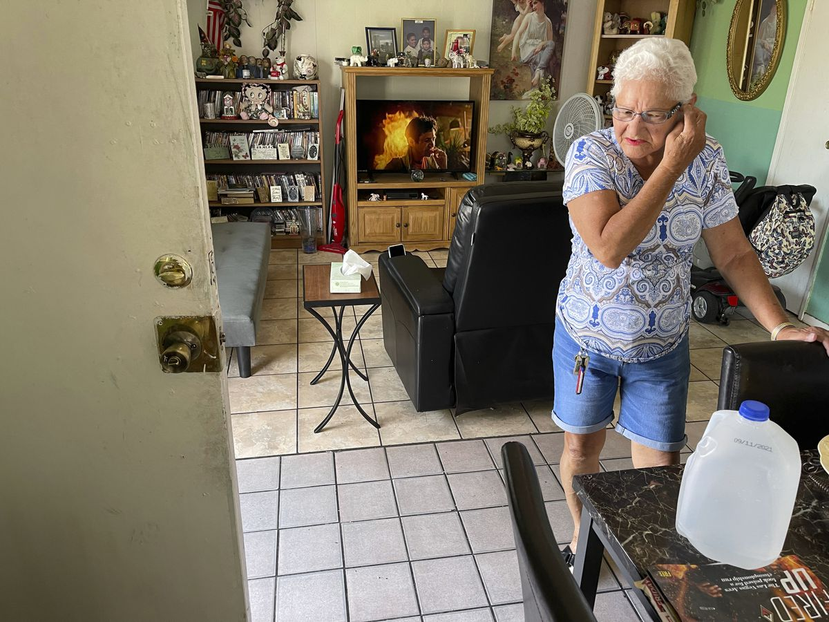 Carmen Millan, 82, uses a fan with open windows and door to keep cool at her apartment on East Desert Inn Road and South Athens Street in Las Vegas Wednesday, June 16, 2021. Millan keeps doesn't run her air conditioning during the day to save money on her electricity bill. (K.M. Cannon/Las Vegas Review-Journal via AP)