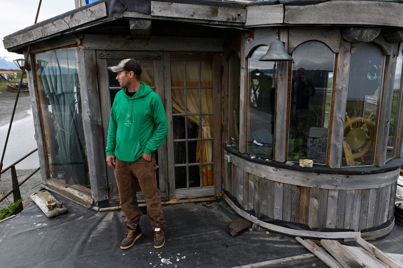 Drew O'Neill lives with his family in an old boat on the Homer Spit. (Marc Lester / ADN)