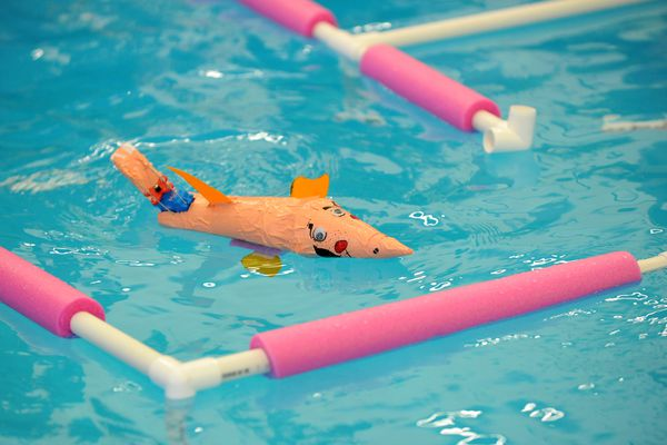 Students in the Alaska Native Science & Engineering Program compete against each other, with the robotic fish they engineered and built, at the UAA pool in Anchorage, Alaska on Friday, July 21, 2017. (Bob Hallinen / Alaska Dispatch News)