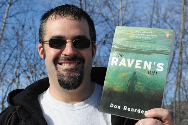 Author Don Rearden with a copy of his book The Raven's Gift on Wednesday, Mar. 16, 2011. (Bill Roth / ADN archive 2011)