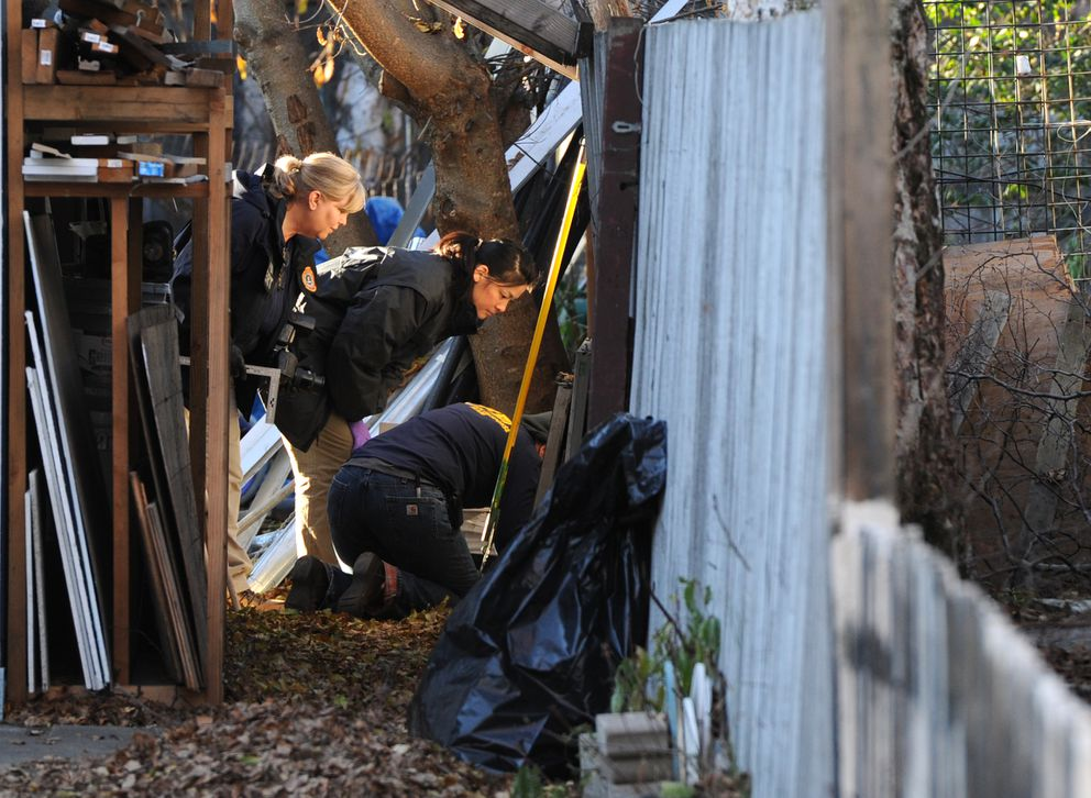 Law enforcement personnel search the home where Israel Keyes lived on Oct. 23, 2012 in West Anchorage. Keyes was jailed in April for allegedly abducting and killing 18-year-old Samantha Koenig in February. (Erik Hill / ADN)