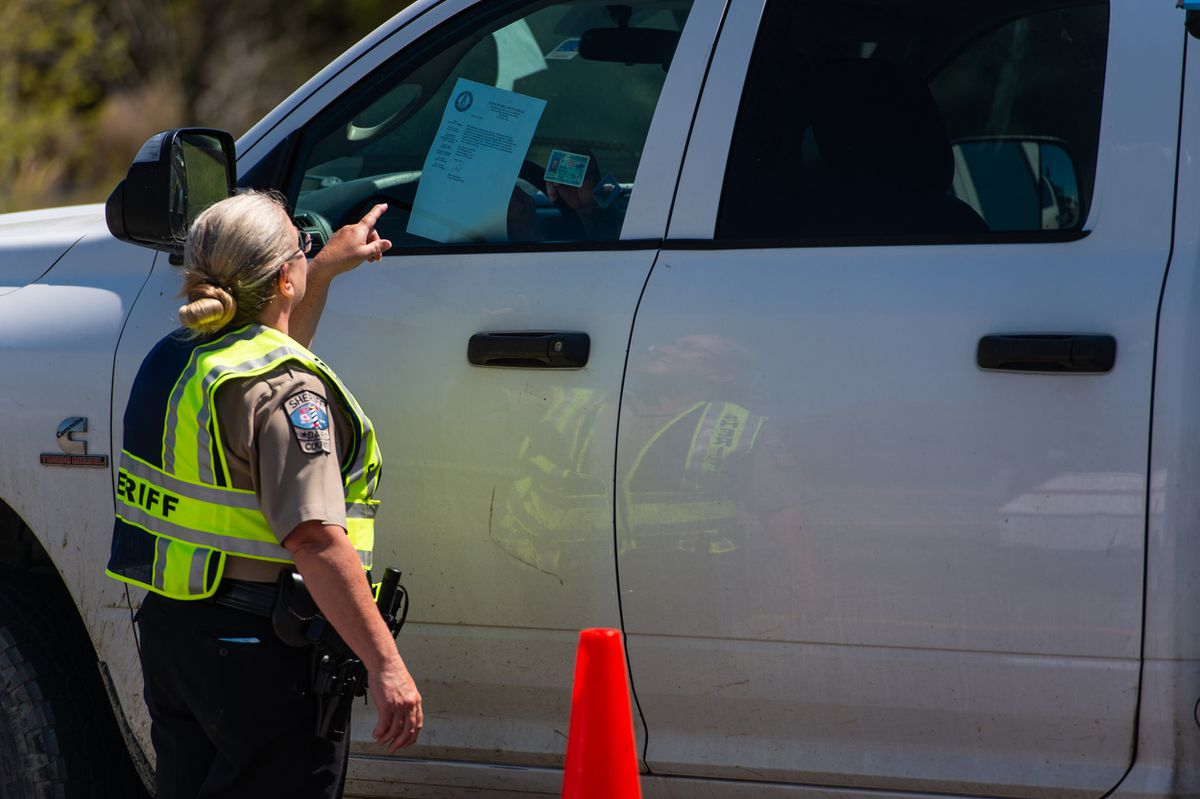 Acceptable forms of identification for entry into Dare County, N.C., include a state driver's license with Dare County address or other acceptable documentation. Shown, an officer at the Wright Brothers' Memorial Bridge in Southern Shores on April 9, 2020. (Photo by Daniel Pullen for The Washington Post) MUST CREDIT: Photo for The Washington Post by Daniel Pullen