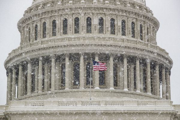 An American flag waves in front of the U.S. Capitol Dome as a winter storm arrives in the region Sunday, Jan. 13, 2019, in Washington. (AP Photo/Alex Brandon)