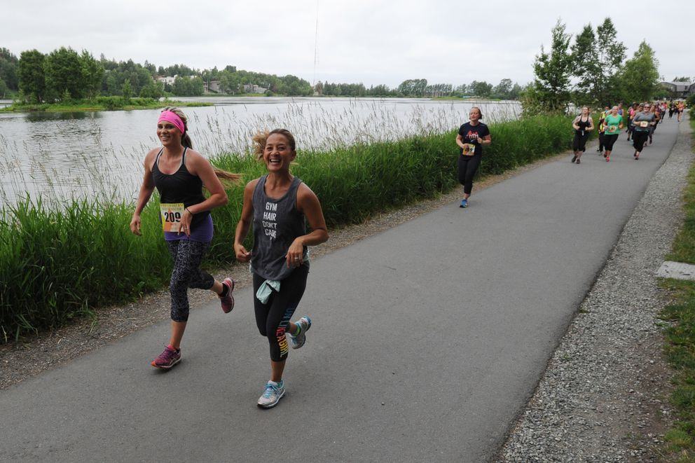 Runners competing in Sunday's Her Tern Half and Quarter Marathon's pass Westchester Lagoon. (Bill Roth / Alaska Dispatch News)