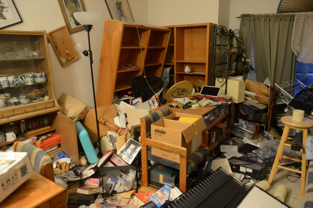 Bookcases emptied and a desktop was cleared in a west Anchorage home by 7.0 earthquakes in Anchorage, AK on Friday, Nov. 30, 2018. (Bob Hallinen / ADN)