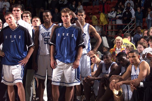 Duke's Trajan Langdon and teammates watch Cincinnati receive the championship trophy at the end of the 1998 Great Alaska Shootout. (Jim Lavrakas / Anchorage Daily News)