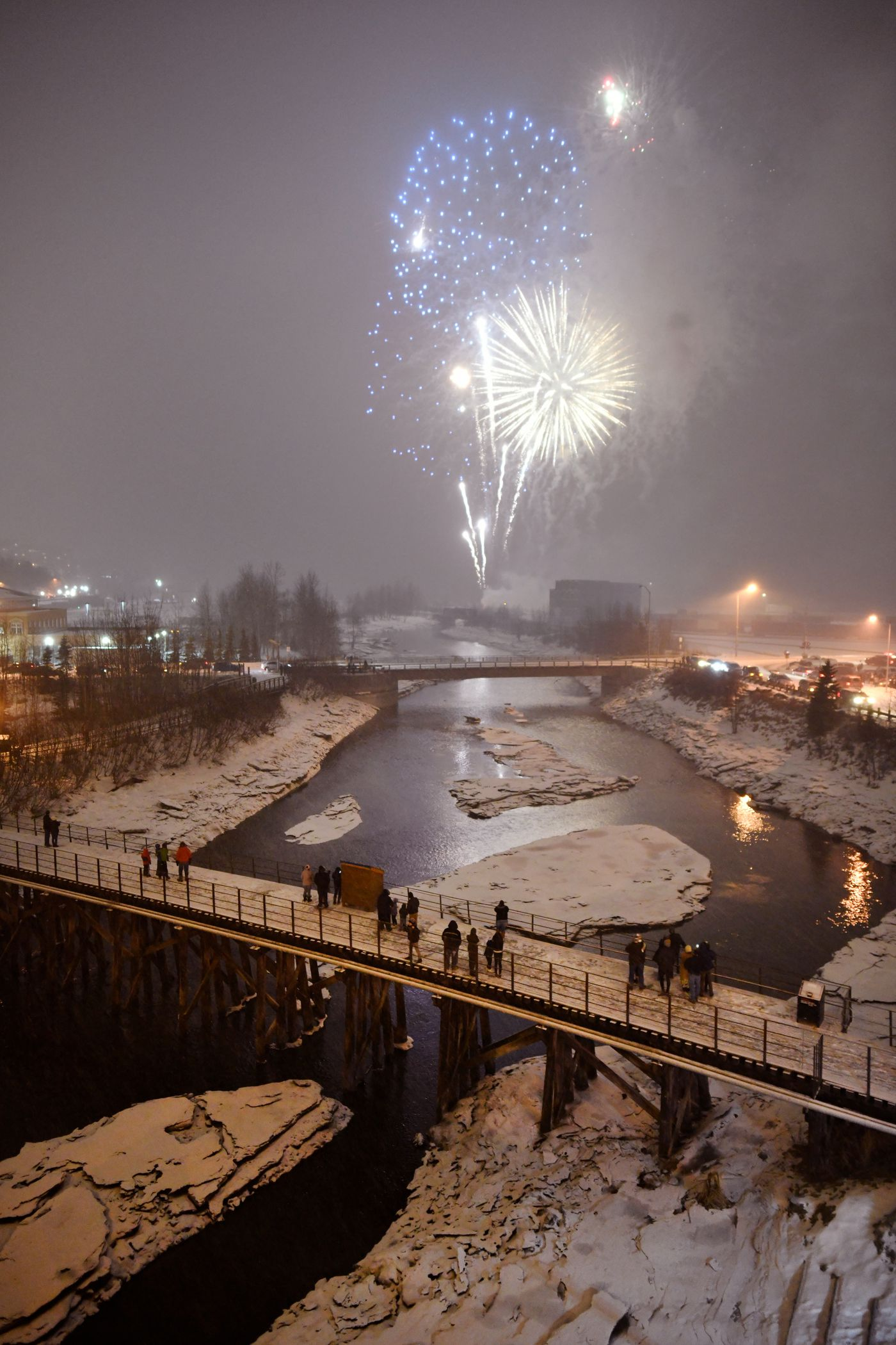 Fireworks light up the sky over Ship Creek. (Marc Lester / ADN)
