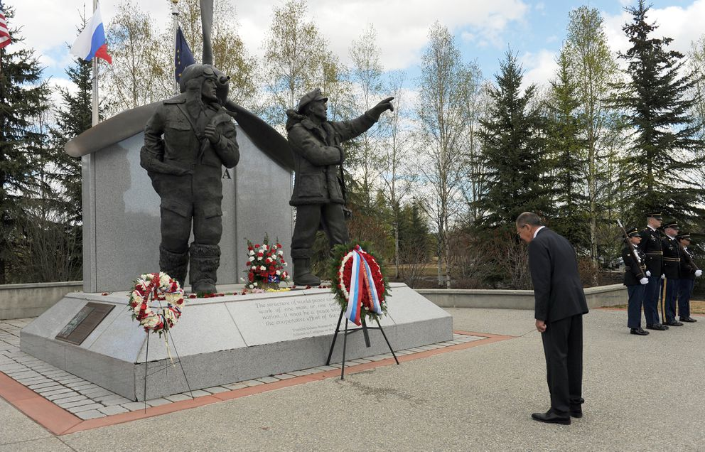 Sergey Lavrov bows his head during a wreath-laying ceremony at the Alaska Siberia Lend-Lease Memorial in Fairbanks on Thursday. The Alaska Army National Guard honor guard stands at attention at right. (Bob Hallinen / Alaska Dispatch News)