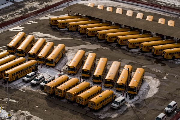 School buses are parked at the Anchorage School District transportation center on Friday, March 27, 2020. Schools have been ordered temporarily closed due to the coronavirus pandemic. (Loren Holmes / ADN)