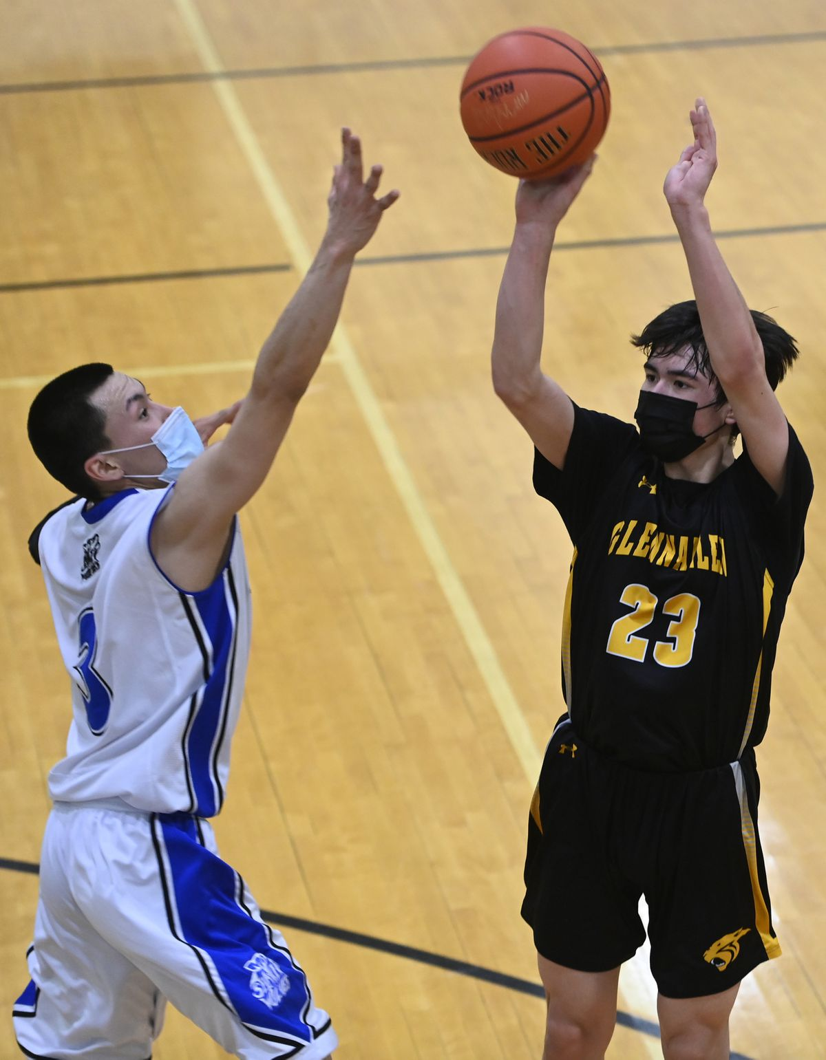 Glennallen junior Hunter Terrel puts up a shot as Selawik senior Axel Snyder defends during the Panthers' 67-46 victory Thursday at the Class 2A state basketball tournament in Palmer. (Bill Roth / ADN)