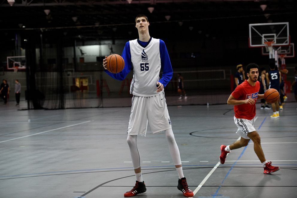 Robert Bobroczkyi, a 7-foot-7 teen from Romania, warms up before the game against Woodstock Academy of Connecticut . The high school sophomore would like to join the ranks of the tallest players in NBA history – Gheorghe Muresan (7-foot-7) who is also from Romania, Manute Bol (7-foot-6.75), Shawn Bradley (7-foot-6) and Yao Ming (7-foot-6). Washington Post photo by Katherine Frey