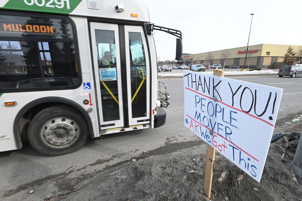 A People Mover bus passes by a sign posted at a bus stop on Benson Boulevard on April 8. People Mover temporarily suspended fixed-route service the night of April 8 but plans to resume service June 1. (Bill Roth / ADN)