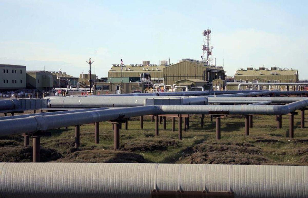 Oil and gas pipelines run into Alyeska's trans-Alaska oil pipeline Pump Station 1 on Alaska's North Slope near Deadhorse.