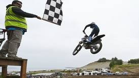 Injuries keep him seated while others stand, but Palmer motocross champion Robert Graeber gets the job done