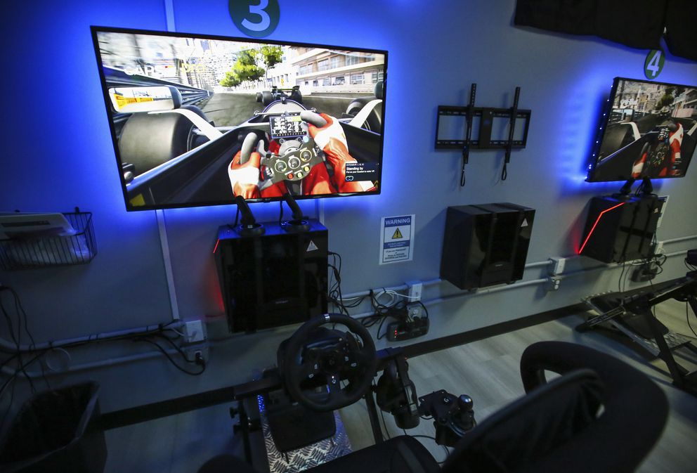 A row of virtual reality racing games is set up along the entrance wall of Vortex VR in Anchorage, photographed on Thursday, April 22, 2021. (Emily Mesner / ADN)