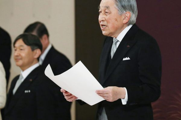 Japan's Emperor Akihito speaks during the ceremony of his abdication in front of other members of the royal families and top government officials at the Imperial Palace in Tokyo, Tuesday, April 30, 2019. The 85-year-old Akihito ends his three-decade reign on Tuesday as his son Crown Prince Naruhito, left, will ascend the Chrysanthemum throne on Wednesday. (Japan Pool via AP)