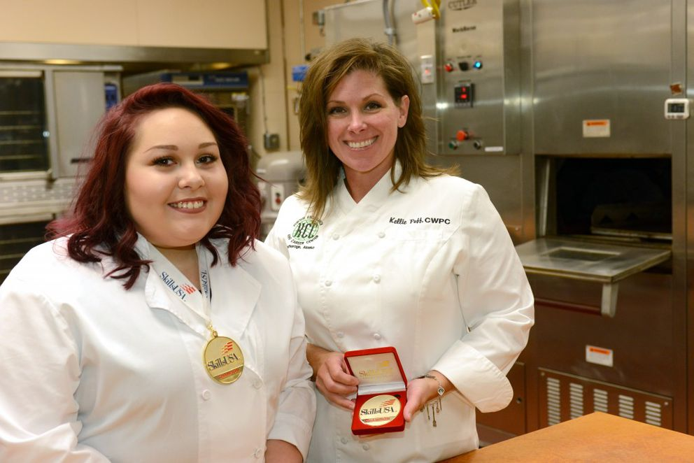King Career Center alumna Jordyn Baker, left, and her culinary arts instructor Kellie Puff earned medals after Baker claimed top honors in commercial baking at the SkillsUSA Championships this past summer in Louisville, Kentucky. She finished first among 43 contestants. Puff helped Baker train after school ended last May before the two headed to Kentucky. (Erik Hill / Alaska Dispatch News)